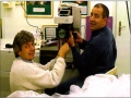 Tibor Juhász, PhD, and Christopher Horvath, PhD, installig the prototype laser at the first clinical site in 1998